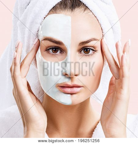 Beautiful woman with mask on her face over beige background. Skincare concept.