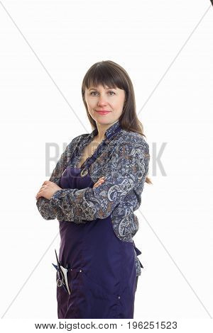 adult woman stylist in upron with tools in hands smiles on camera isolated on white background