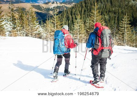 Two Climbers Are In The Mountains.