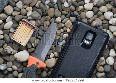 Box With Matches, Folding Knife And Smartphone