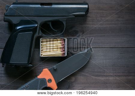 Survival Kit For Tough Man. Gun, Knife, Matches