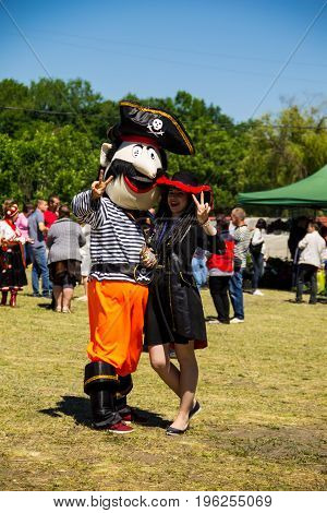 Couple Dressed In Pirate Costumes During Strawberry Festival