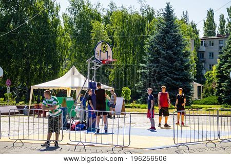 Kremenchug Ukraine - June 5 2017: Basketball players on basketball playing field before game outdoors on festival Extreme-zone