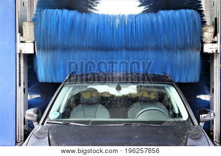 An image of a car wash - washer