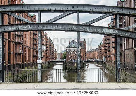 HAMBURG GERMANY - JULY 14, 2017: Water flowing around the popular Water Castle in the warehouse district of Hamburg