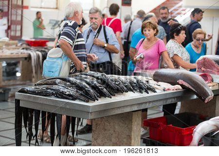 FUNCHAL PORTUGAL - SEPTEMBER 2 2016: Tourists visiting the fish market of the famous Mercado dos Lavradores on May 02 2014 in Funchal capital city of Madeira Portugal
