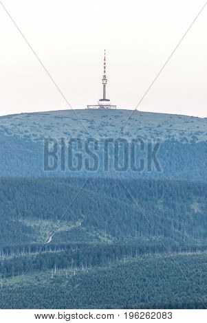 Praded hill with communication tower from Cervena hora hill in Hruby Jesenik mountains during twilight