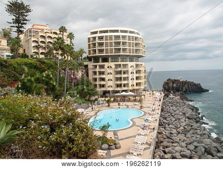FUNCHAL PORTUGAL - SEPTEMBER 3 2016: Swimming pool with tourists at Lido hotels zone in Funchal Madeira island Portugal