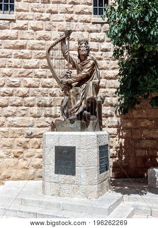 Jerusalem Israel July 14 2017 : The statue of King David with harp near entrance to his tomb on Mount Zion in Jerusalem Israel