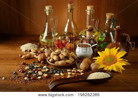Still life seeds and oils useful for health(Flax, sesame, sunflower, olives, walnut, peanuts)