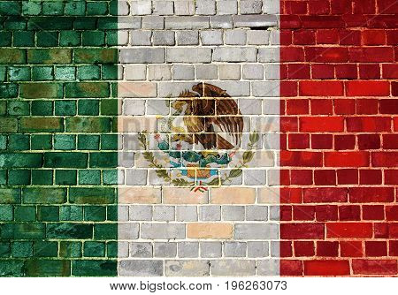 Mexican flag on an old brick wall background