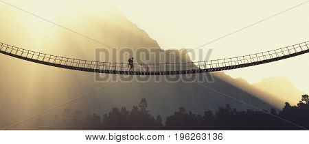 Man with backpack on a rope bridge. This is a 3d render illustration