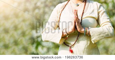 Yoga position in a girl's prayer in summer