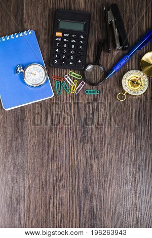 Notepad, Pen, Calculator And Compass On The Table.
