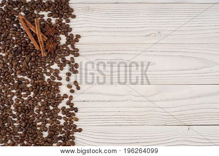Coffee beans with star anise on old white table. Top view.