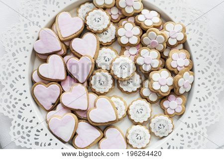 mixed pink and white glazed cookie biscuits on tray