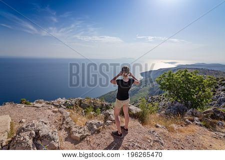 Woman Taking Photo From The Top Of Mount.