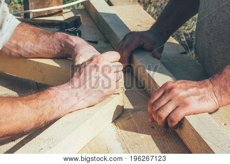 the hands of the workers carpenters joiners