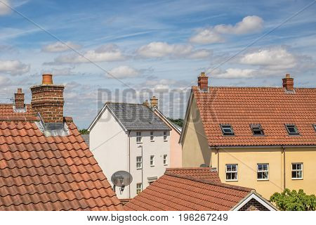 Suburbs. Roof top view of residential suburban housing estate. Mixed house buildings.