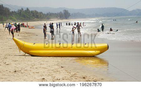Alibaug / India - April 04, 2017 - People enjoying on the sea shore in India
