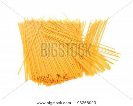 A thick heap of long spaghetti isolated over the radiant white background. Tasteful nutritious carbohydrate dishes. Traditional mediterranean meals for gourmets.