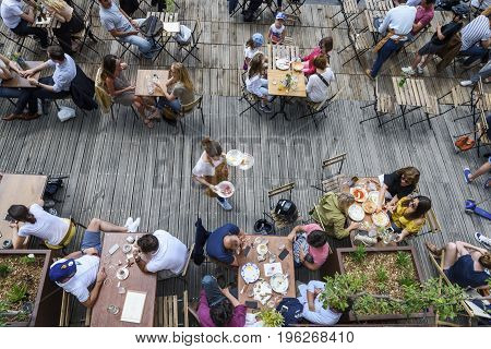 Paris June 5 2017 : people is havin lunch in a terrace restaurant relaxing and friendly moment style of life.