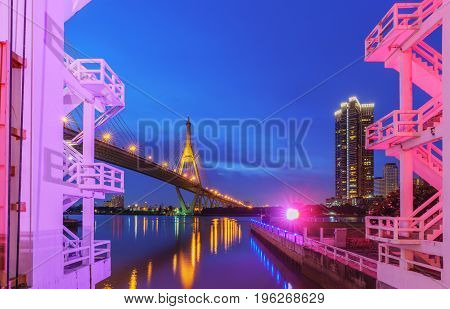 Bhumibol bridge 1 so called Industrial Ring Bridge crossing The Chao Phraya River with reflection Bangkok Thailand ( Foreign text saying Bhumibol bridge 1 )