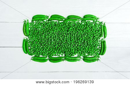 Top View Of Frame From Fresh Green Peas And Pods On White Background, Free Space, Food Background, F