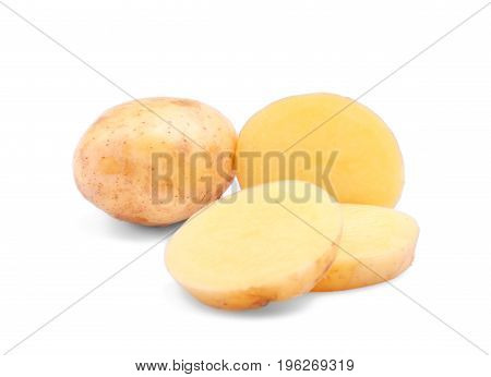 Raw, fresh sliced light brown new potatoes, isolated on a white background. Healthful and organic agriculture ingredients for cooking. Delicious potatoes for vegetarian diets.