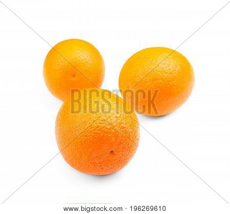 A bright group of three tasty, juicy bright oranges, isolated on a white background. The composition of three ripe oranges. Citrus fruits. Nutritious vitamins.