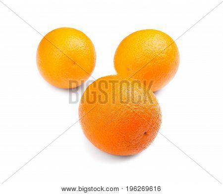 Three ripe, juicy and healthy oranges, isolated on a white background. Fresh, natural and bright orange vitamins. Ripe citrus fruits. Nutritious vitamin C.