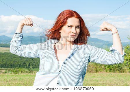 Beautiful Young Woman Showing Her Muscles