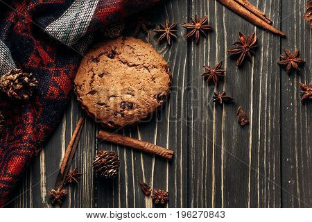 Cookie Anise Cinnamon And Pine Cones On Wooden Background, Stylish Rustic Winter Flat Lay. Space For