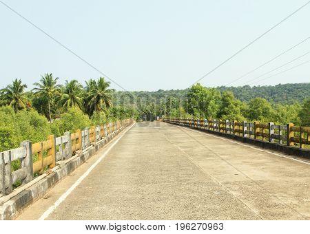 Empty road over a bridge in the tropics