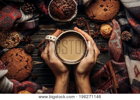 Stylish Rustic Winter Flat Lay With Hands Holding Coffee Cookies And Spices On Wooden Background. Sp