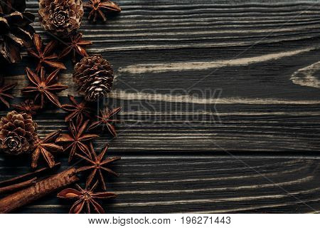 Anise And Pine Cones On Wooden Background, Stylish Rustic Winter Flat Lay. Space For Text. Cozy Mood