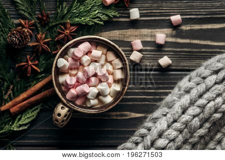 Stylish Rustic Winter Flat Lay Of Cup With Colorful Marshmallows Cinnamon And Anise And Big Yarn On