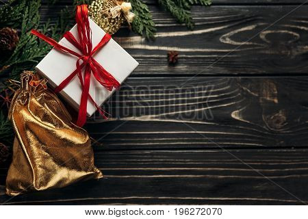 Christmas Presents With Red Ribbon And Golden Ornaments On Stylish Rustic Wooden Background Flat Lay