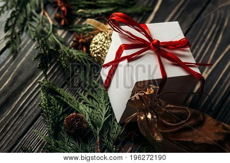 Stylish Rustic Christmas Wallpaper With Presents With Red Ribbon And Golden Ornaments On Wooden Back