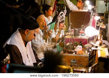 A Group Of Chinese Opera Member Prepares At Backstage