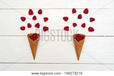 Top View Of Sweet Fresh Organic Raspberries In Waffle Cones. Fresh Berries In Cones On White Wooden