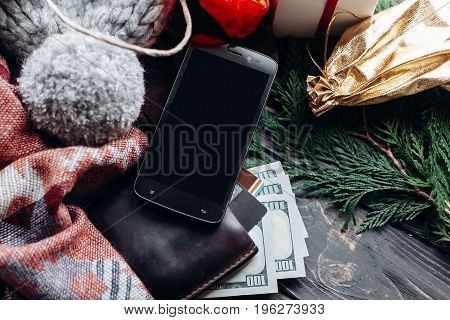 Christmas Shopping Concept. Big Sale. Seasonal Rustic Background With Phone With Empty Screen Money