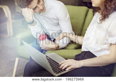 Business meeting in office young entrepreneur working together flirting at workplace love mood. using laptop.