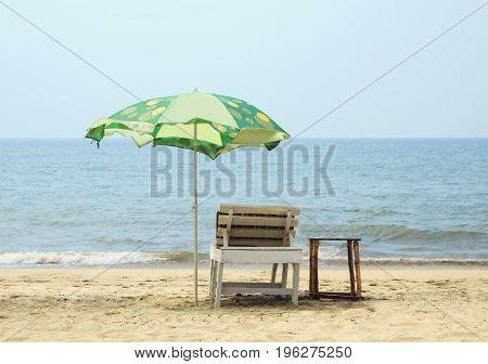 Chair with Umbrella on the Beach near ocean