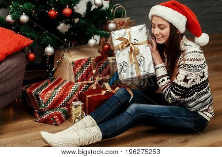 Beautiful Happy Emotional Woman In Red Santa Hat And Reindeer Sweater Smiling After Receiving Christ