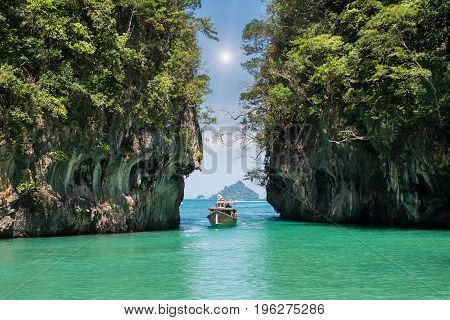 Beautiful landscape of rocks mountain and crystal clear sea with longtail boat at Phuket Thailand. Summer Travel Vacation Holiday concept.