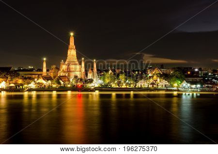 The Temple of Dawn in Bangkok Thailand. Wat Arun on Chao Phraya river and a beautiful night sky in Bangkok Thailand.
