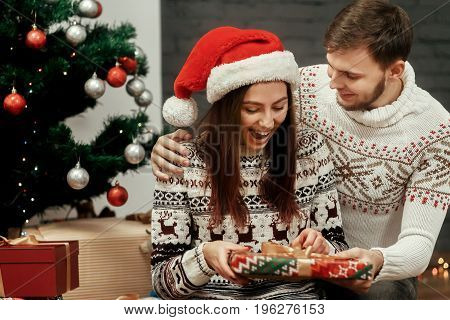 Excited Happy Woman Receiving Big Surprise Present From Her Husband. Joyful Cozy Moments In Winter H