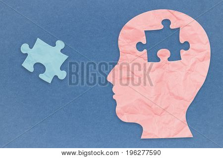 mental health concept with 3d rendering side face and jigsaw pieces