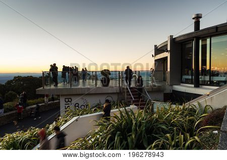 Gold Coast, Australia - July 11, 2017: people on the beach at Surfers Paradise, a popular tropical holiday destination with substantial highrise development.